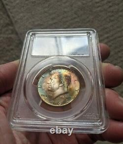 1964-D Kennedy silver half dollar PCGS MS65 rainbow toned obverse and reverse